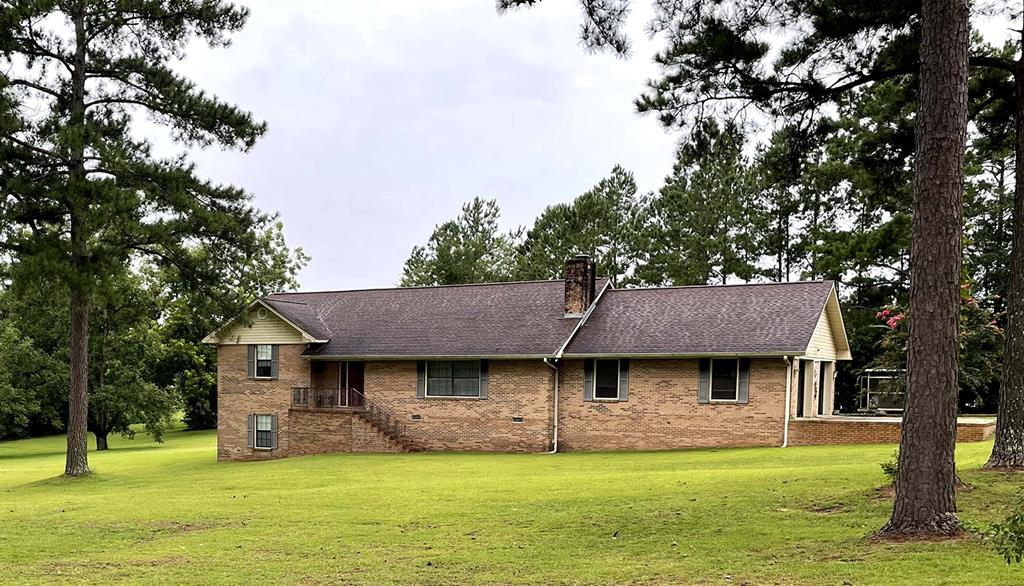 Big, Brick, Boston Beauty!   2,391 Sq Ft  Brick . split level home on 2.21 acres tucked away in the edge of Boston city limits. 2 spacious master suites, main with sitting area, with large walk -in  closets, huge living room with wood burning fireplace, large open dining room/eat in kitchen with tons of cabinets adjoin laundry/mudroom area with  dedicated bath. Massive partially finished attic which was constructed when the house was built to accommodate future living space. Two car garage large enough for most trucks and SUVS. Separate 30x40 metal garage with electricity and concrete floor is the ultimate workshop. Many recent updates including recent interior paint, new light switches and electrical outlets, recent dual HVAC systems, thermostatic attic fan, AcuRite monitoring system, roof, windows, vinyl siding with soffits,  brand new crawlspace encapsulation, moisture barrier, dehumidifier and sum pump. City of Boston Utilities means no well or septic tank to maintain and reasonable utilities and taxes . This well maintained home offers country living with city comforts  at your fingertips. TABOR lockbox under garage . 24 hour showing notice required.