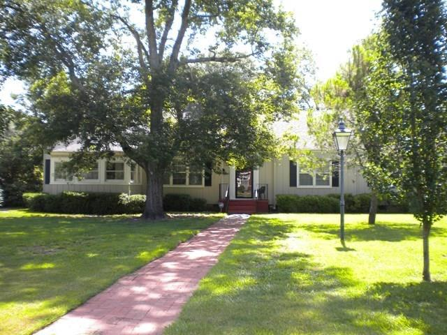 Super large home in the heart of Moultrie!  You'll find 5 bedrooms and 4 baths in this home packed with charm and character.  The den boasts exposed wood beams, a wood burning fireplace, and an attached wood oven.  It has a farmstyle kitchen and breakfast/dining room, a sunporch, hardwood floors, and a basement.  You will find a fenced backyard, 16X16 cooled workshop, and a storm shelter situated on almost 3/4 of an acre (corner lot).  The living room and master bedroom both have fireplaces.  Make an appointment for your personal tour!