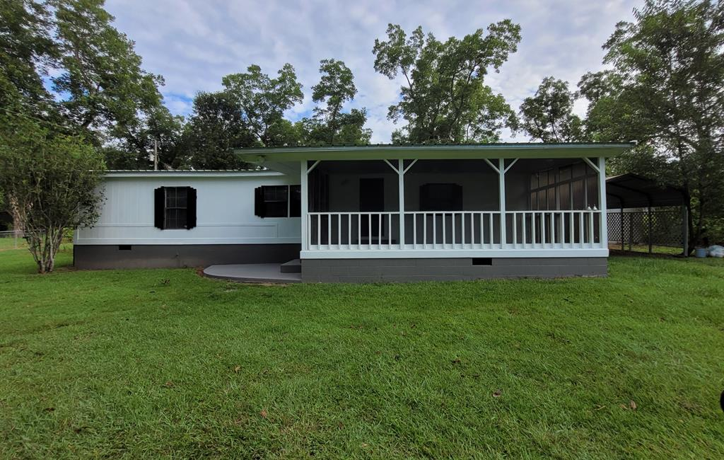 Great home for the growing family/first time buyer.  Open floor plan of this 3br 2 bath home is perfect for a family.  Freshly painted inside and out, new flooring, and almost new roof make this a bargain.   A front screened in porch, patio, rear deck and swimming pool make it great for entertaining.  A wired workshop/storage building and a 2 car shelter makes this home highly desirable. Call today- It will not last long.