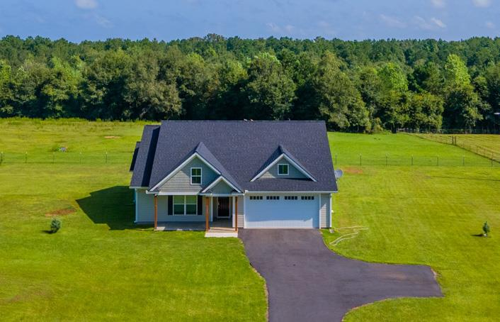 Looking for a well built, newly constructed home on some acreage?  Check out this 1739 sq. ft., 3 bedroom 2 bath house on 13 acres.  The floors are vinyl planking in the living areas and tile in the bath and laundry rooms.  The main bedroom suite has a walk-in closet.  The main bath has his/her sink, granite counter tops and a walk-in shower.  Enjoy your morning cup of coffee on your screened in patio over looking your fenced in pasture.  Property is fenced and gated.