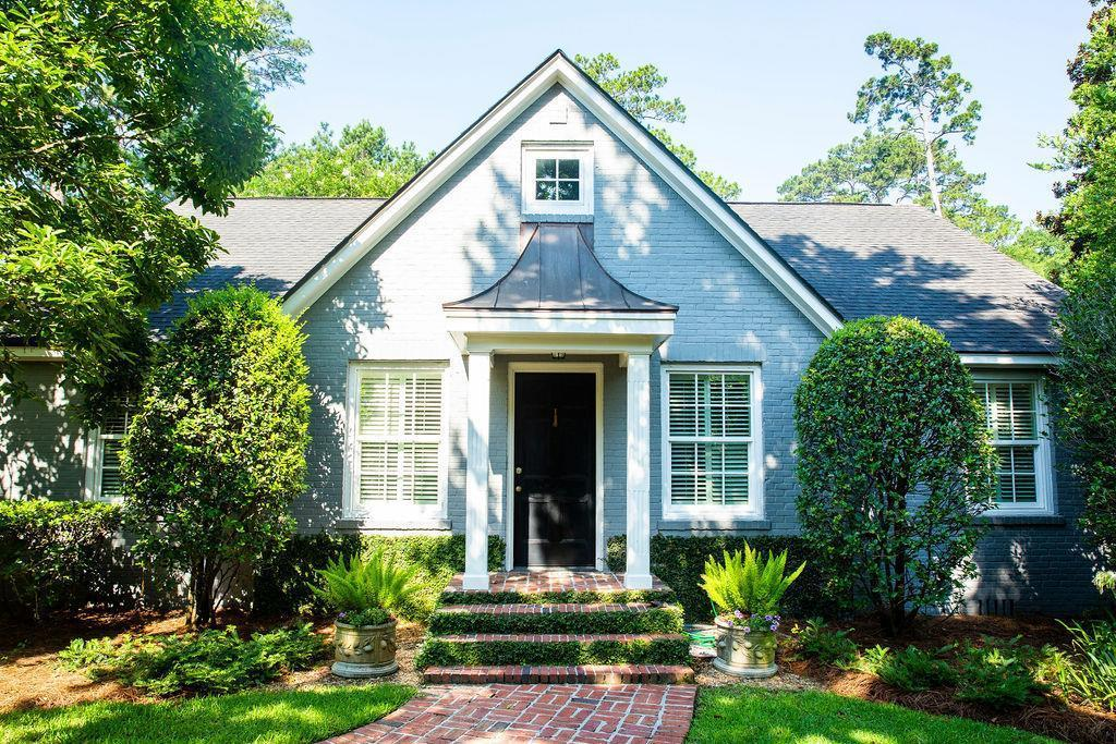 Nestled on 1 acre near downtown Thomasville, this unique welcoming home is over 4,000 SF with 4 bedrooms and 4.5 baths.  Recent renovations include energy efficient windows, a spacious, vaulted, master bedroom, luxurious master bath, walk in wine closet,  and office. Loads of natural light, hardwood floors throughout, plantation shutters, custom closets, crown molding, and a 3- zone HVAC are just a few of the custom amenities that make this house special. Downstairs hosts a formal dining  room, two family rooms, private office, master bedroom, guest room with full bath, sunporch, and an open kitchen to one of the living rooms.  The sunlight-filled kitchen boasts a commercial-grade stove, stainless steel appliances and an ice maker in the adjoining wet bar.  Upstairs houses 2 bedrooms with private baths and a charming play area.   Mature trees and a stunning landscape on a fully-fenced 1 acre lot, large brick aggregate patio, outside shed with lockable storage and a grilling area.