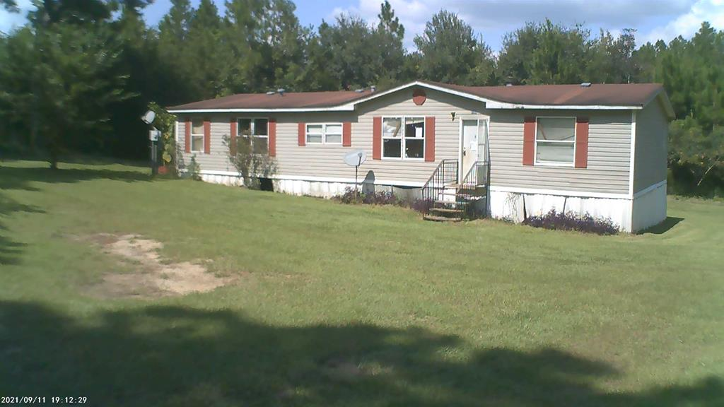 """If you are looking for peace and quiet, this is it! Space is over three acres with your own well.  Subject is a 1995 Peachtree mobile home.  Property is sold in """"as is"""" condition with no warranties."""