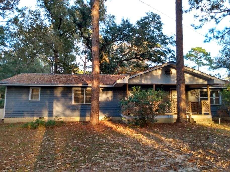 POTENTIAL is the best way to describe this former Air Force barracks turned residential home. Space is no issue with this three bedroom, one bath home, with 1856 square feet of quiet country living. Three large bedrooms feature plenty of space for all of your furniture. There is a large area off the master bedroom that could be turned into a master bathroom, walk-in closet or nursery. Outside features front and back porches, along with blueberry bushes, a fig tree, pecan tree, yellow rose bush and gardenias. The lot beside the home is included in the sale, which is 1.03 acres suitable for mobile or site built home.