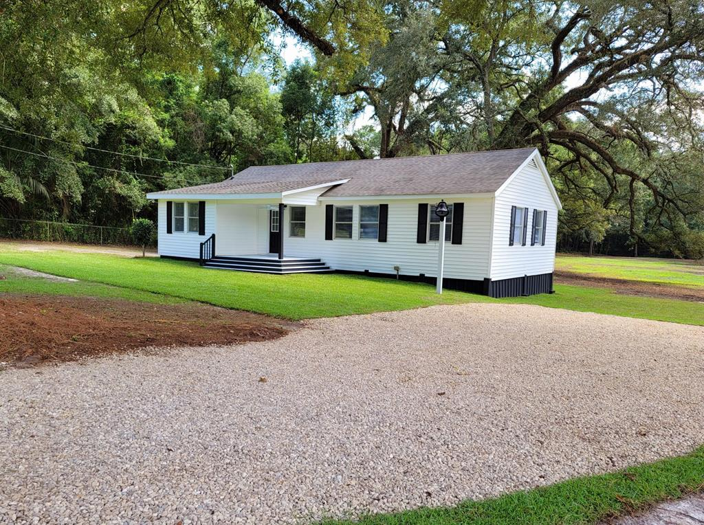 You will find updates throughout this home that any buyer is sure to fall in love with. The home sits on approx 5.31 acres and has mature trees, firepit, swing and plenty of room for the whole family to enjoy. The open-concept kitchen has all new appliances and tons of cabinet space. On the other side of the kitchen is the livingroom that has a fireplace and tons of natural light. The master bathroom has a private bath with a walk in, tiled shower. This split floorplan has a total of three bedrooms, two baths and an office or additional space for a playroom. Tons of unique details are sure to catch your eye. There is a large back deck that would be great for entertaining. Call today to view this great home.