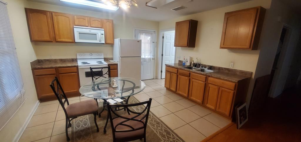 Great starter home features 3 bedrooms and 2 bath which sits on a large fenced-in corner lot.  Only a couple blocks from downtown and minutes from schools and shopping.  Enjoy the evenings and early mornings on the screened in front porch.  Home is fully wheelchair accessible featuring ramp to enter the home and wide doorways and hallway throughout this home.  No money down financing available with approved credit.  Call to find out more today!