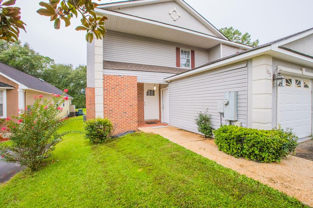 MOVE-IN READY!  Lots of recent improvements and updates to this spacious townhouse over looking the pond at the Courtyard by Shoreline---super convenient location in the county at the back of Tall Timbers Village.  2 bedrooms &  2.5 baths in 1580 sf has 2 master suites on the upper level with lots of storage.  Upgrades throughout include new flooring (laminate wood and carpet), paint throughout, new bathroom fixtures, new light fixtures, granite counters in kitchen.  The combo living and dining area has a fireplace and easy access to the covered porch and open deck in the fenced in yard.  The upper master suite has a screened porch for pond views.  Plus this home has a one-car garage.  Low annual HOA fee of $250 covers yard maintenance.  Call today to schedule an appointment.