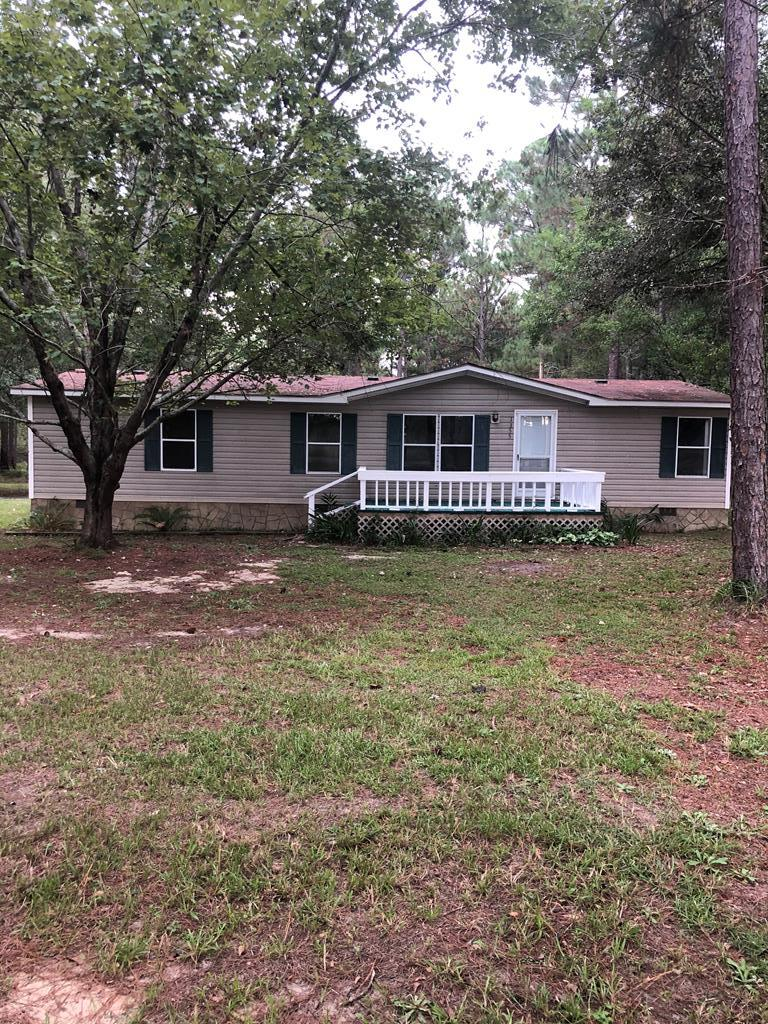 Move in Ready!!!  If storage is what you need this home has it!!!  This property has 12.01 acres of land, 1994 mobile home that has a permanent foundation 3 bedrooms 2bath, open floor plan, newly painted. Renovated with upgraded flooring throughout.  All bedrooms have walk in closets.  Upgrade 4 ton A/C unit and maintained by Waller.  There is a 3/4 acre pond filled with fish.  The back acreage is wooded and has deer, turkey, and ducks.  The property has two driveways.  A 26x30 insulated workshop that has a concrete floor, lights, a 30 foot lean-to off the back.and concrete pad in the front.  Make your appointment today.  Country living at its Best!!