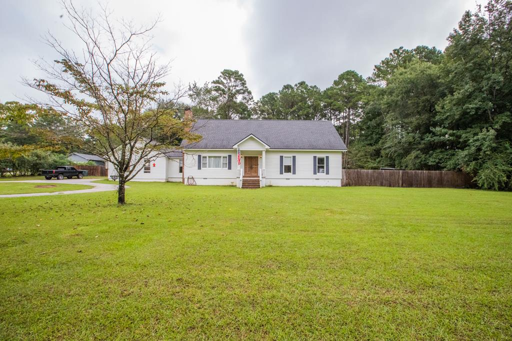 Location with plenty of space.  This 4 bedroom 3 bath home sits on a 1.15 acre lot in a great location and has 2856 sq ft.  The property backs up to the popular subdivision  A Place in The Woods. This property features 4 large bedrooms and 3 full bathrooms.  As you enter, you'll see a large open living room, that has a wood burning fireplace.  The kitchen is open to the large dining room.  The master is downstairs along with an additional bedroom and bathroom.  Upstairs you have 2 additional large bedrooms and a bathroom that has double vanities.  All of the bedrooms have good sized closets and plenty of space in the walk in attic space.  The backyard is completely fenced in for pets or for the kids to play.  Call today to schedule your private showing.