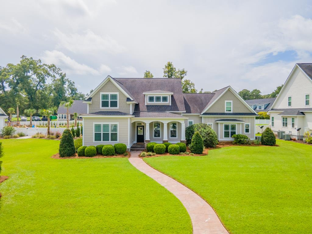 Thomasville's premier swim clubhouse community!  You will love one of the most unique and custom floor plans in Madison Grove as it features spacious and thoughtful living spaces.   Five bedrooms and 4 full bathrooms in 4750 sf, built in 2011.  For today's modern WFH family, it includes a large office space with access from main house and garage.  Other spaces include formal dining, open family room, breakfast room, entertainment room and game room. The well appointed kitchen has granite counters with center island plus stainless appliances including a warming drawer in the range. The main level features 2 bedroom suites...the primary with oversized master bathroom featuring a claw foot tub with double vanity & closet and the other bedroom suite is suitable for guests. The laundry room is a unique pass-through plan perfect for todays busy families with the installed PureWash Pro system for sanitizing laundry, ideal for healthcare professionals or anyone needing the extra assurance of worry free laundry.  Lots of upgrades including beautiful hardwood floors throughout (no carpet), high ceilings, large moldings, abundant storage, custom light fixtures, gas log fireplace, custom built-ins and more!  Easy to maintain yard includes professional landscaping and sprinkler irrigation system plus a beautiful patio area for grilling and enjoying the outdoors. It's all true! You have to see it to believe it!