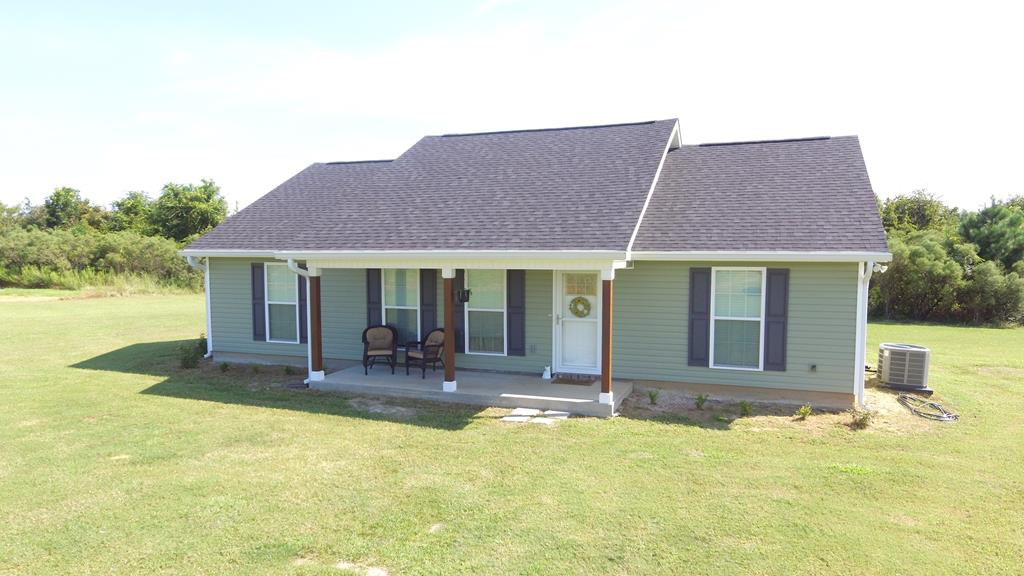 If you have been searching for WIDE OPEN SPACES, this is the place!! This charming 3 bedroom/2 bath home in Pavo is practically brand new and sits on 45+ acres of land. Inside, you will find a generous open floor plan, combining the living/dining room with an attractive modern kitchen. The primary bedroom features its own bathroom, complete with walk in closet.  Two other bedrooms and bathroom on the opposite end of the house create plenty of room for the family, with handsome laminate wood floors throughout. From the front porch, you will take in the most memorable views of rolling farmland and the open sky  perfect for wine and stargazing! To  see this amazing property, call your favorite Realtor TODAY!!