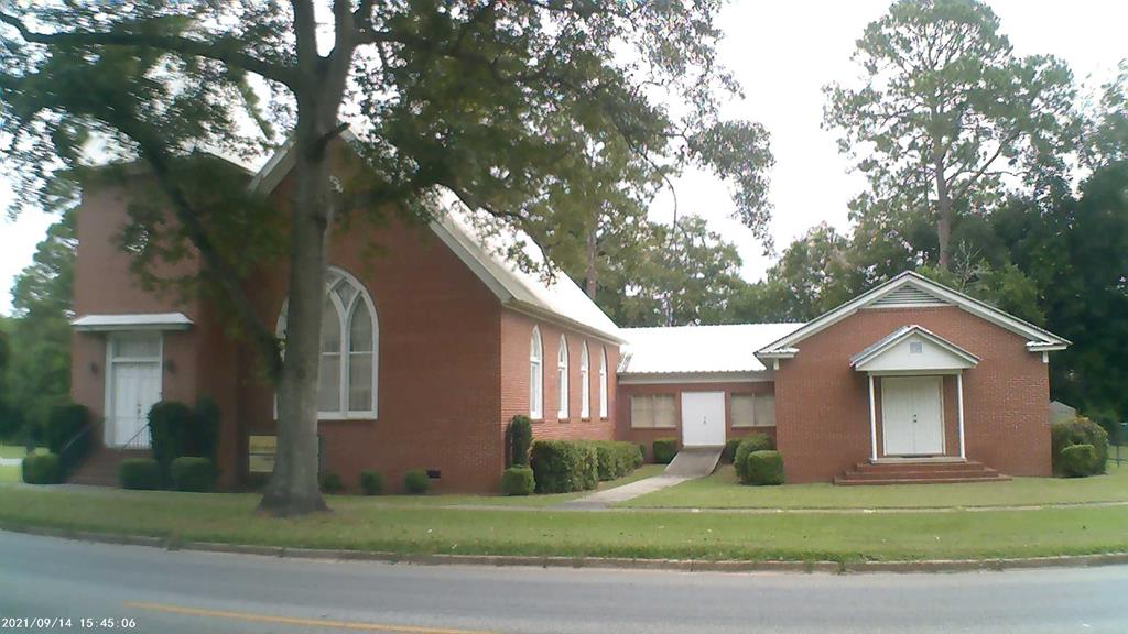 Property has been very well maintained. It has a metal roof and is brick veneer  construction for ease of maintenance.  There  property has three working HVAC  units at time of listing.  The sanctuary seats approximately one hundred people. All equipment except the sanctuary piano goes with the building.   The adjacent corner vacant lot is also to be sold with the property. The fellowship hall has a kitchen with  stove,  microwave oven and refrigerator and  eight folding tables and chairs.  Building is sold in as is condition with no warranties.