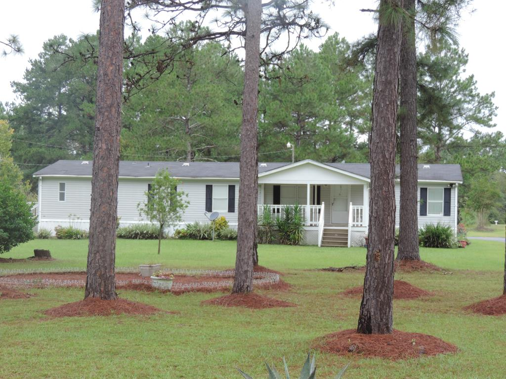 Peaceful surroundings can be found with this countryside home and beautiful wooded lot. Home is immaculate and features 4 bedrooms, living room, den with fireplace and all bedrooms have walk in closets.  Huge laundry room with side exit. Paved drive. Storage building with utilities.  Private well.