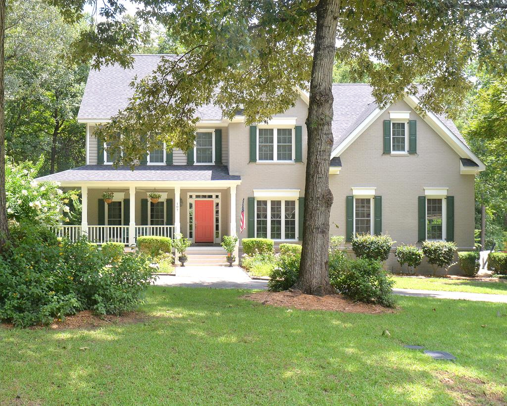 Newly renovated Georgian Style home with a wraparound front porch. This 4 bedroom, 4 bath home sits on 1.7 acres . It is on a quiet street and walking distance to the Woods Club, neighborhood pool and playground. The interior features an open concept floor plan with high ceilings and plenty of  natural light.  The family room has 20 foot ceilings and a wood burning fireplace overlooking private woods. The updated kitchen has granite counter tops, new stainless -steel appliances, recently painted wood cabinets, custom butchers island, new light fixtures and a walk in pantry. Sunroom with new double pane, Low E windows. Formal living and dining room. Downstairs bonus room (5th bedroom, office, studio). Close proximity to private/public schools and downtown make this home a great place to raise a family.  Loft with built ins. Master suite with large walk-in closet, large master bath with jacuzzi tub, walk in shower, double sinks, water closet and large walk-in closet. New hardwood floors throughout home (carpeted hallway and loft upstairs). Freshly painted interior and exterior. Ready for your family to move in.