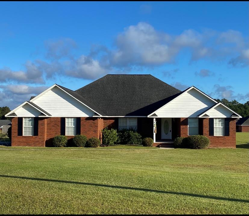 Beautiful brick home located in Willow Ridge Subdivision on a Large Corner Lot. This brick home features 4 Bedrooms, 2 1/2  Baths, approx. 2739 sq. ft Inside and over 3000 sq.ft.under roof. Spacious Kitchen w/  Extra custom stain cabinets .Stainless Steel Appliances including Stainless Steel Refrigerator, Dishwasher , Smooth Top Range, and Built-in microwave. Ceramic tile floors, Plush carpeting, Wood Flooring. Breakfast room, Formal dining, Split bedroom design . Large Master Bedroom w/ his & hers vanities &  Large Walk In Closet and  Garden Tub,& Separate shower. All other rooms are a good size w/ walk-in closets. Beautiful Jack & Jill Bathroom to accommodate the family. Freshly Painted inside. Architectural shingles, Double garage w/ opener and Outside Keypad.. Underground utilities. Subdivision has a nice Lighted Walking Area. Just A Few Minutes from Shopping and Schools.