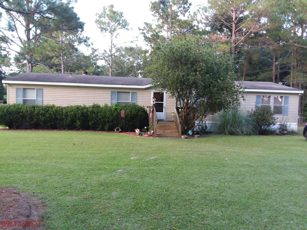 Attractive 4Br. 2Ba. manufactured home with fenced back yard and workshop.
