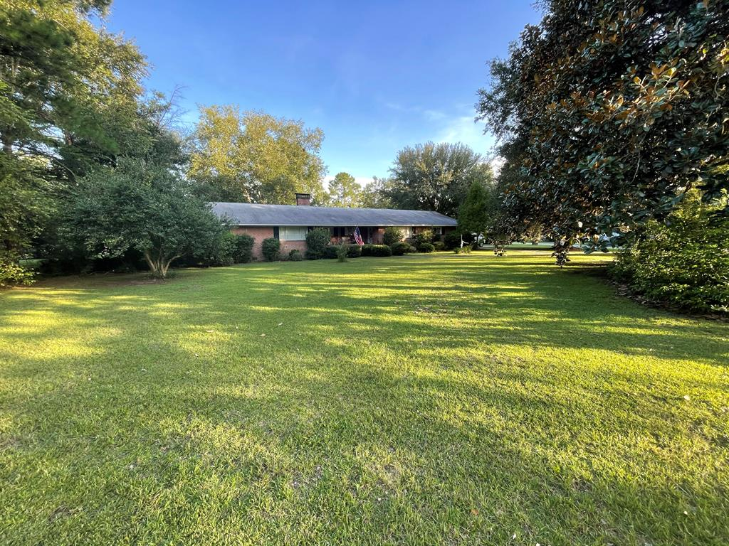 Ranch style 3bd/2ba brick home with road frontage on all 4 sides and 1 ac lot in Whigham, GA!  This property is conveniently located in between Cairo and Bainbridge and offers an easy commute to Tallahassee.  This home offers a split bedroom floor plan with over 2,100 sq.ft.  Owners have made recent updates in the kitchen and installed new vanities in the bathrooms.  There is a large family room with double sided fireplace shared with master suite.  There's an extra room that could be used for a home office or sitting room, large screened in back porch, 2 carport, and workshop/lean to.  The yard is of good size and has plenty of room for your kids or fur babies to enjoy.  Call today to schedule your private tour.