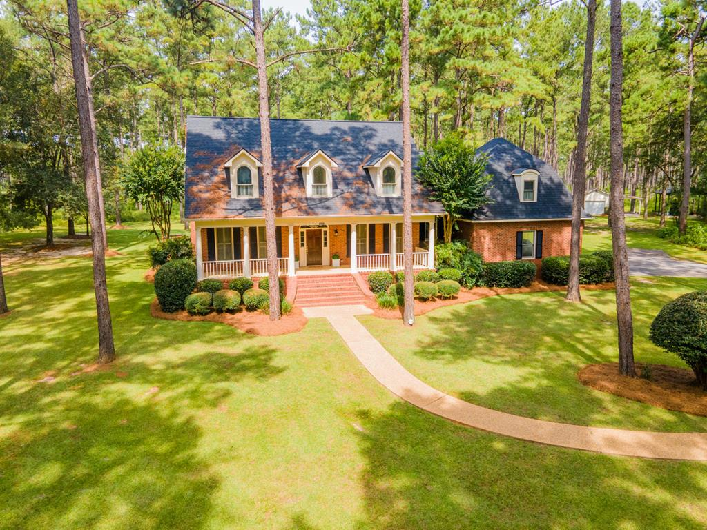 Country living just minutes from town.  Beautiful brick home built by Mallory Parker sits on 11.97 acres of gorgeous well maintained woodland.  This 4 bedroom 3  bath home has 3,982 square feet and is perfectly laid out for easy entertaining   The welcoming foyer is flanked by a traditional dining room and living room that could also be used as an office.  This space leads to a gracious great room with a wood burning fireplace and opens on to a large updated kitchen with yet another large eating area looking over the backyard and woods.  This space then spills onto a covered porch and large patio.  The entertaining potential is great for any size group.  The main level master suite is very gracious and is private from the other bedroom space.  Upstairs has 3 good sized bedrooms/2 baths and a bonus room.  This home has been meticulously maintained  please call for a showing!