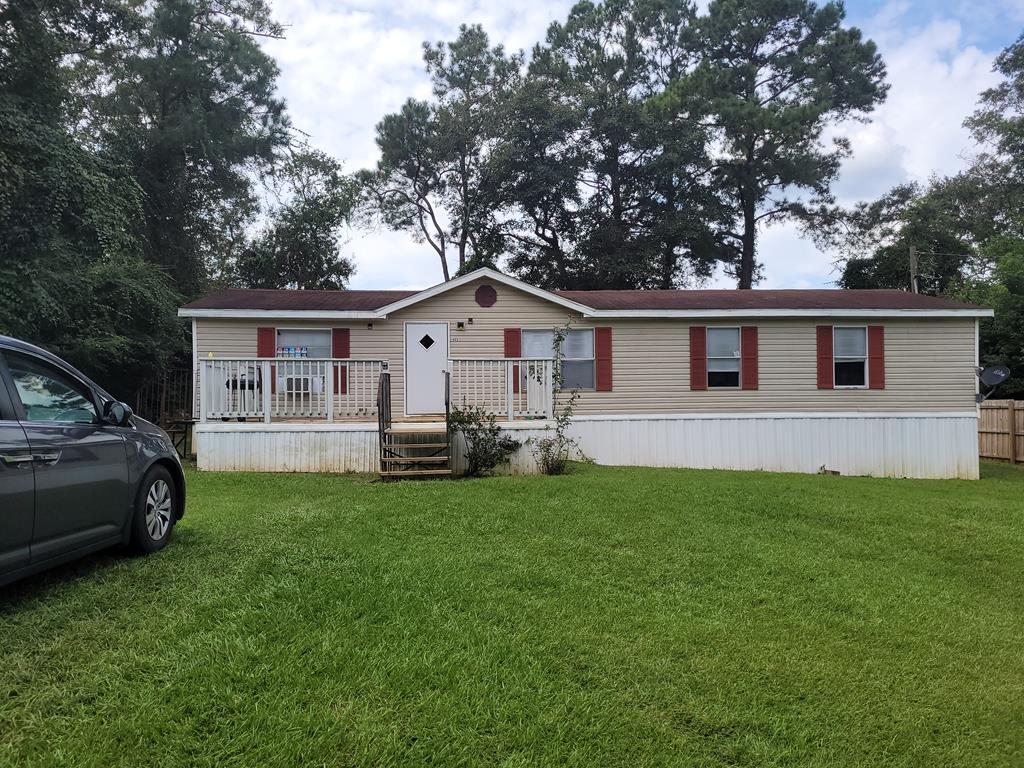This 4 br 2 bath with HVAC is a great home for the first time buyer and family.  In a quiet area on a large yard, there is room for all!  Front and back decks, and privacy fences make the out doors perfect for kids and entertaining.  Lots of room inside for a growing family, investors look at the present rent of 950.
