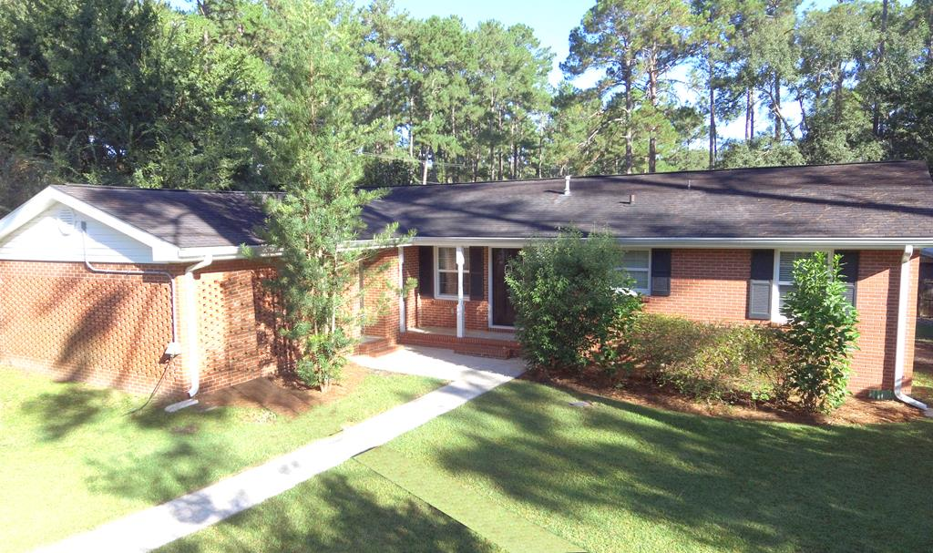 Comfortable, quaint suburban living at its finest! This 3BR/2bath home on the corner of Lakewood and Lullwater is cozy enough for everybody with its1523 square feet of living space. As you walk in from the double carport, you'll be immediately greeted with fresh paint and hardwood floors throughout. Directly ahead is your open floorplan of dining area and kitchen, and after a long day of work, relax in the living room with gas log fireplace and built in bookshelves for all of your literature. Three generous sized rooms meet you down the hall, along with a beautifully themed hall bathroom. With cooler weather finally settling in, the sunroom off of the kitchen is perfect for watching the sunset over the shade trees. Outside you'll enjoy the fenced in backyard with your own mature orange tree, lemon tree and blueberry bushes, along with a two-year-old 12X16 storage building with its own window unit! Call your favorite Realtor to EXPERIENCE this amazing home.