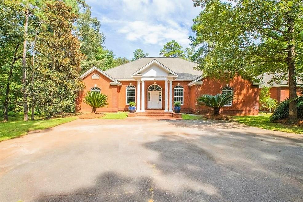 Newly painted and impeccably designed for the family that wants to live in a quiet subdivision that is private and is professionally landscaped. Located on 3.39 acres in Pebble Creek Subdivision, this 4 bedroom/3 bath split floorplan brick home is almost maintenance free and is just waiting for you to enjoy the outdoor living space that is centered around the stocked pond that leads to the lake. Master bedroom with large master bath and walk-in closet is a dream come true!  Bonus room is perfect for that pool table, ping pong table or just make it something that fits your needs. The kitchen is in the heart of the home that is located so the cook can be a part of watching the game, enjoying the fireplace or cooking up something for family & friends to enjoy!  Two gar oversized garage has ample space for storage and is connected to a workshop!  This home has a relaxing feel with soaring ceilings, hard surface countertops, crown molding, hardwood & tile flooring throughout.  Can't wait to see it?  Make an appointment today as you won't want to miss out!