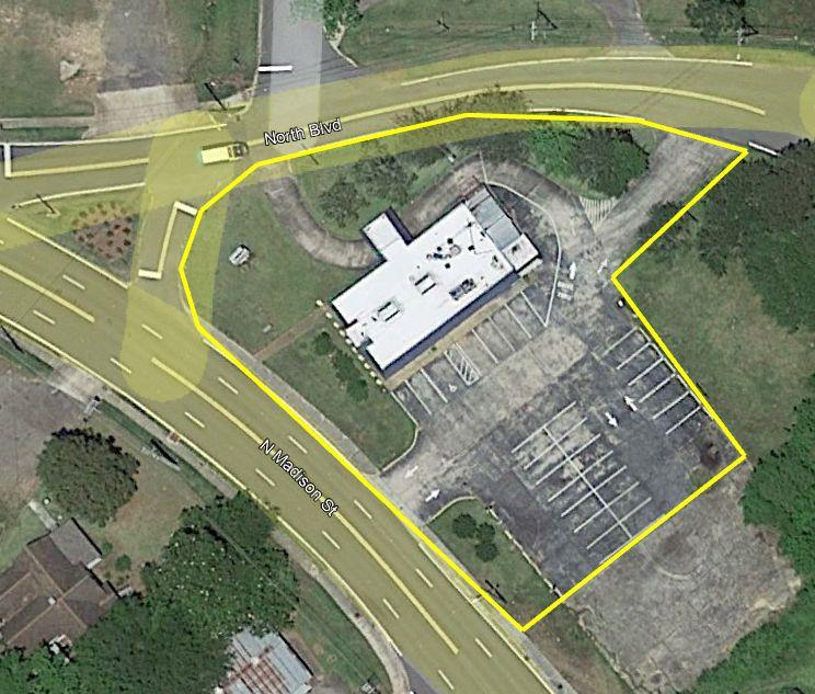 .69 Acres with vacant building.  Mostly paved site with plenty of parking, drive-thru and a corner lot with over 400' of frontage with good viz and great accessibility   Situated on the main North Corridor coming into downtown Thomasville.  Growing industrial and business area near this site. Increased residential development to the north of this site.  Consider Commercial Zoning and look at the permitted use table for Commercial Zoning in the City.  There are a world of uses for this site.  Uses to consider might be:  Food Service, Day Care, Medical, Business, Payment Center- Consider the recent impact of COVID Pandemic and how business saving having a Drive-Thru has been for business owners. Building has been empty for sometime and needs updating and work.   Has been leased in the past.