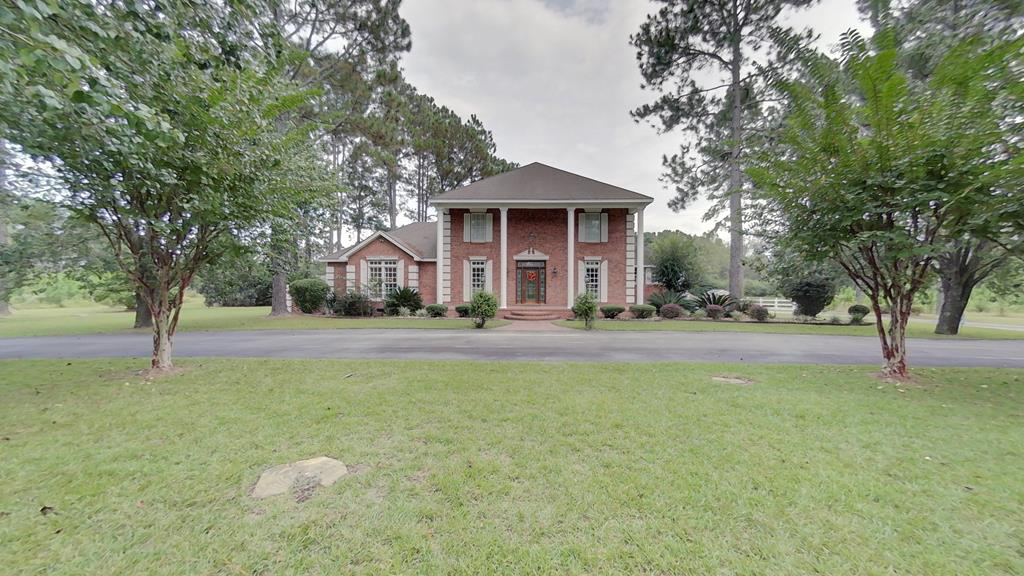 Peaceful, stunning, grand, immaculateI could keep going! As you enter the driveway, youre greeted with beautiful landscaping that defines the circular drive. This home is nestled on 25.82+/- acres with pine trees, a stocked pond and the closest neighbor just a short drive down the road. Walking in the front door, you immediately feel right at home. To your left youll find the stairs and the main floor master bed and bath. This master bed and bath has it allhis and hers vanities, toilet room, his and hers walk in closets, a large garden tub and separate shower; master bedroom is large enough for your bedroom furniture and a sitting area, a set of french doors that lead out to the screened porch. As you leave master bedroom, youll find the stairs to the 2nd story; 3 bedrooms and a full bath with double lavatory sinks. Youll find a formal dining with plenty of space to have many great family dinners, off the dining is the kitchen. This kitchen offers a breakfast nook that over looks the back yard and pond, hard surface counter tops, stainless steel appliances, double ovens, stove top on the kitchen island, plenty of counter space and an abundance of cabinet space. The laundry room offers a sink, a half bath and a separate shower. The living area is great for family nights and entertaining guest. The family room offers a gas fireplace and doors that lead out to the screened in porch. The screened porch offers a wood burning fireplace, space for family and guest and the best part the HOT TUB! Enjoy the view of the pond from the porch or grab your fishing pole and lets fish! Youll also find a guest house with a dock, great for the kids to have a place to set up a game room or great for a man cave or she shed! Lets not forget the large wired workshop, which is great for those weekend projects. This beautiful property has it all! Call today to schedule your tour.