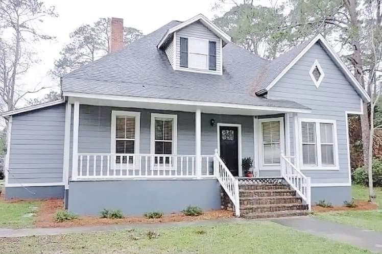 This spacious single-family home in downtown Cairo features modern amenities and architectural character in a very convenient location. Having been recently remodeled, this house is outfitted with granite countertops in the kitchen and bathrooms, as well as new cabinetry and stainless steel appliances. Sitting on a large .45 acre corner lot, this 2879 square foot home has a spacious downstairs that boasts 2 bedrooms, 1.5 baths, kitchen, formal dining, and a living room. A den/office space could also double as a third bedroom downstairs. The upstairs showcases a full master suite with master bedroom, bathroom and large walk in closet. Upgrades throughout the home include new flooring, countertops, cabinets, appliances, and a new architectural roof installed in 2019. With its convenient location to restaurants, stores, schools, and entertainment, this home wont last long. Schedule your showing before it is gone!