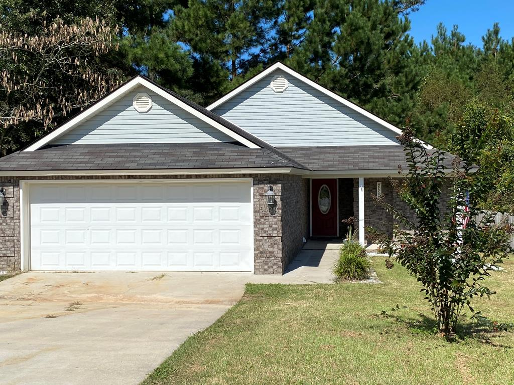 This is a wonderful FOUR BEDROOM starter home that is located near schools, and downtown.  It's on  a cul de sac and one of the nice features of the home is the tray ceiling in the living room and also in the master bedroom.. It's a split plan with the master on the other side of the living room from the guest rooms.. There's a doulbe car garage and a big deck off the back .  The trees out back give the backyard a more private setting for relaxing.  If you are looking for a home please call your agent and see this one!!  MORE PICTURES COMING