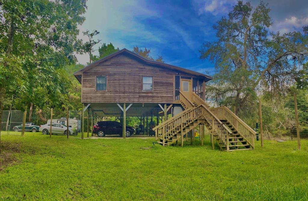 """Beautiful getaway home on the Ochlocknee River. This cabin has two bedrooms and two full bathrooms, a fireplace, screened porch, and an open deck. There is also a concrete patio for grilling and family gatherings. Inside has wood floors and walls with an open floor plan. The cabin comes with all household furnishings, including a washer and dryer. Looking for a Beautiful secluded weekend getaway! Well, this is it! Located on the Ochlocknee River, This 3bed 2 baths 1200 sqft. Has everything you're looking for and more, the wonderful cabin has so many things to love! An open floor plan that looks onto the river. This home is perfect for entertaining guests with its large screened porch and the large area underneath to grill and relax. Enjoy the comfort of fishing for Bass, brim, and catfish, from your own backyard. This is also a great area to put in a kayak or canoe and float on the river. Cmon, this is a """"Must See"""" for river life."""