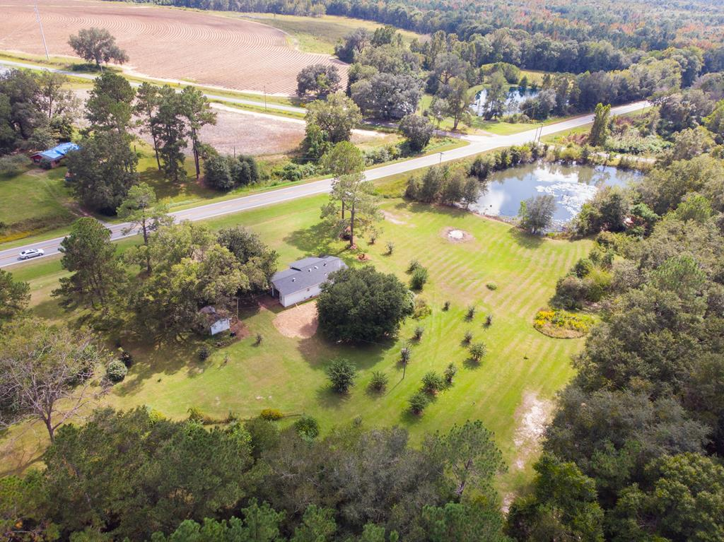 BEAUTIFUL SETTING!!!  Great well maintained one owner home minutes from historic Downtown Quitman!  This home sits on 7.3 Acres with beautiful view of private pond.  Other homes could be added to the property.  Make an appointed today!!