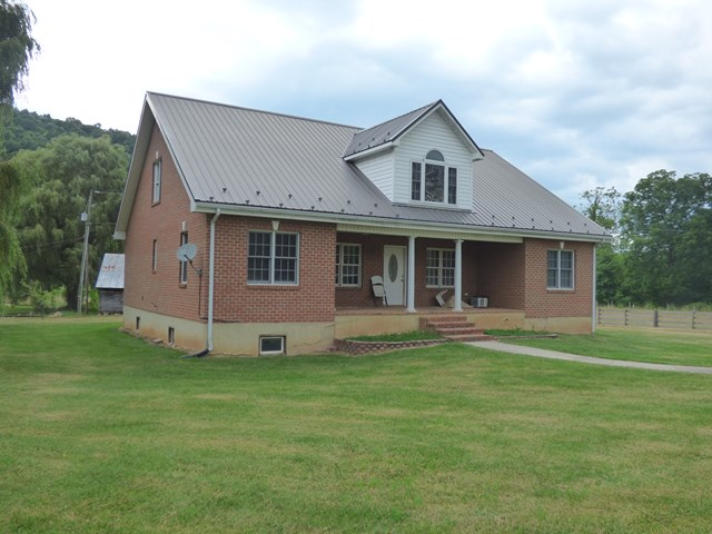GREAT OPPORTUNITY TO OWN A BEAUTIFUL 128 ACRE WORKING FARM WITH A LARGE 4BR 3 BATH HOUSE PLUS MANY OUTBUILDINGS. THE PROPERTY IS MOSTLY OPEN WITH APPROX 20% WOODED.  LOTS OF ROAD FRONTAGE. HOME BOASTS A LARGE KITCHEN, HARDWOOD FLOORS, LARGE DEN WITH GAS LOG FIREPLACE, SPACIOUS COVERED DECK ON THE REAR OF THE HOME, DEN AREA UPSTAIRS WITH TWO LARGE BEDROOMS AND SO MUCH MORE. THE LAND HAS BEAUTIFUL   ROLLING HILLS AND FLAT MEADOWS. WILDLIFE ABOUNDS AND THE PROPERTY ALSO JOINS THE NATIONAL FOREST! PROPERTY IS IN THE CREP PROGRAM AND IS FENCED AND CROSS FENCED AND IS TRUELY A WORKING FARM.COME TAKE A LOOK AT THIS WYTHE COUNTY PASTORAL PROPERTY TODAY.