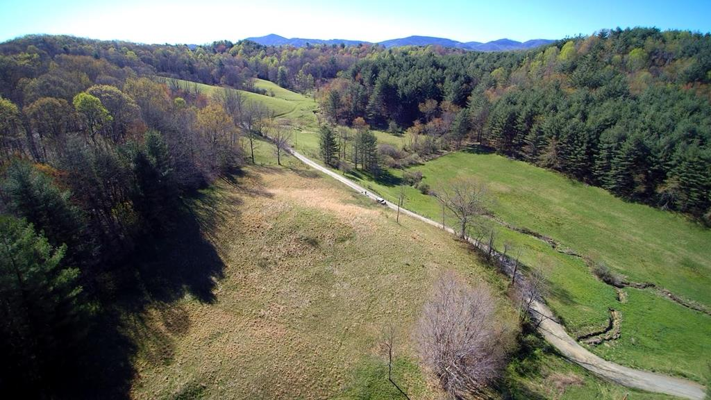 12.45 acres in Blue Ridge Mountains. This is a buildable, unrestricted tract of land that is conveniently located between Sparta NC and Independence VA. It is very close to the New River and easily accessible off a state maintained road. It consists of about 3 acres of pasture with the balance in woodland. Nice neighborhood, surrounded by other agricultural parcels, it's quiet and peaceful with good mountain views. Come and take a look!