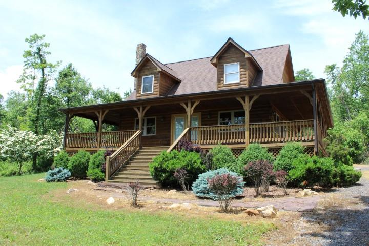 1.5 Story log home in excellent condition  located in Patrick County, VA  (76 Glenburn Lane, Meadows of Dan, VA 24120). Main floor: Kitchen, Dining Area, Living room with cathedral ceilings and wood stove, Master bedroom and Master Bath.  Second floor: 2 bedrooms and full bath. 2.5 acres of land. Land is level to rolling.  Long range views of mountains. Landscaped beautifully. Graveled driveway. Located in River Ridge  Estate with a common area for all residents and guests which has access to the Dan River and a large picnic shelter. Fishing. Restrictions. Owner had the cabin re-stained and new window treatments in the house in August 2016. Enjoy country living at its best.