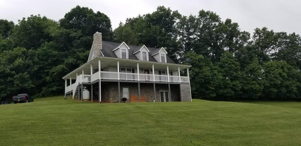 GREAT SETTING FOR THIS NEWER CAPE COD HOME NESTLED WITHIN +/- 3.0 ACRES, LOCATED JUST SOUTH OF THE TOWN OF INDEPENDENCE.  THIS HOME HAS PLENTY OF ROOM FOR YOUR FAMILY WITH A TOTAL OF 2,084 SQ. FEET, FEATURING 3 BEDROOMS AND 2 1/2 BATHS.  FULL WALK-OUT BASEMENT OFFERS A FINISHED FAMILY ROOM TAT HAS A WOOD STOVE FOR THOSE COLD WINTER DAYS, HALF BATH AND PLENTY OF ROOM FOR STORAGE.  RELAX IN YOUR FRONT PORCH SWING AND ENJOY GREAT VIEWS OF THE BLUE RIDGE MOUNTAINS FROM THE WRAP AROUND FRONT PORCH.  THIS HOME IS MOVE-IN READY CONDITION; RECENTLY UPDATED KITCHEN, NEW PAINT THROUGHOUT,  NEWER LAMINATE WOOD FLOOR COVERING IN UPSTAIRS BEDROOMS, AND LOTS OF CLOSET SPACE.  ALSO, A DETACHED 36'X22' WORKSHOP/UTILITY BUILDING FOR YOUR HANDYMAN PROJECTS OR ADDITIONAL STORAGE.