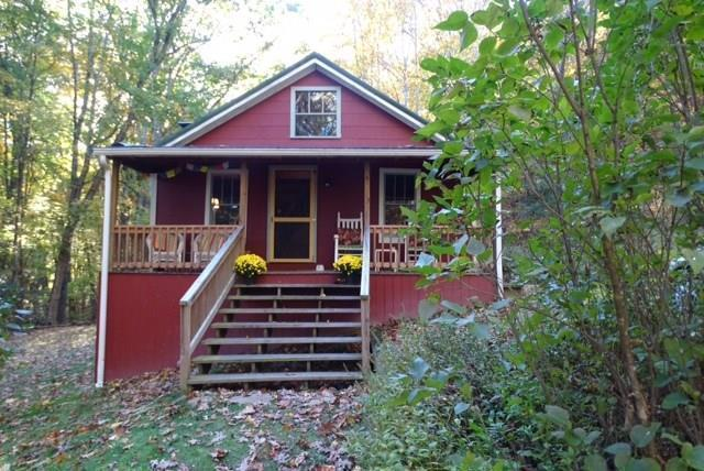 43.2 Acres Surrounded by Jefferson National Forest on 3 SIDES!, plus a Very Charming Cottage! The House was Originally Built @1940, but was fully Renovated and Restored in 2005. The Interior Consists of Wood Plank Walls and Ceilings. There is a Nice Large Rocking Chair Ready Front Porch. A 16x12 Deck was also Added to the back in 2013. The Master Bedroom is located on the main level, and there is a Loft Currently being used as the 2nd BR The Owners kept the original Hardwood Floors and Wood Windows for added Character and Appeal. Offering Privacy, and Nicely Tucked Away down a Level Drive, this is a very Attractive Option for a Relaxing Weekend Getaway in the Cool Mountains of Grayson County. The Land is Primarily Wooded, with @3-4 Acres in front that Could be used for Pasture. Several springs and branches throughout. One even has a small waterfall!  Superb Seasonal views of the surrounding mountains make this the ideal Mountain Retreat!