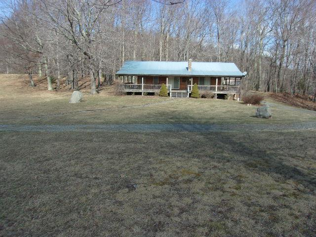 74.01 near level & rolling acres.  Cabin with over 1200 square feet. Pond.  apple trees.  Big timber.  Private & secluded with state road frontage.     8x16 Gazebo.  24x24 out building. 12x10 storage building and a 10x24 pole shed.