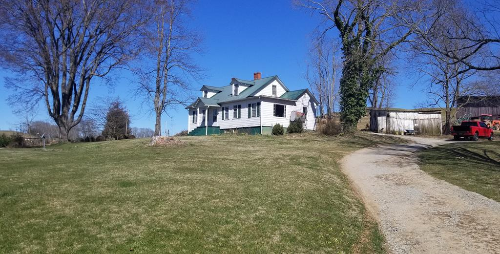 PRICE REDUCTION! A bautiful 57 acre farm in the Mouth of Wilson area of Grayson County. Country living at its best with a 1 1/2 story home built around 1910 with 4 bedrooms and one bathroom with beautiful original hardwood flooring and an enclosed rear porch ( home has plenty of potential to add another bath or add an addition). Behind the home there is a small outbuilding and barn. The property has some spectacular views atop the main open field that are breath taking and would also make an excellent spot for a new home if desired. It has approx. 5 to 6 acres of hardwoods and has good fence all round and has been cross fenced. New watering trough has been installed and ready for your livestock. This is a great piece of property and hard to find in this area and ready for you to move in and start farming or just sit back and enjoy the beautiful Blue Ridge Mountains! If you are looking to get close to nature this is it and you are only minutes from town and also to our National Forest.