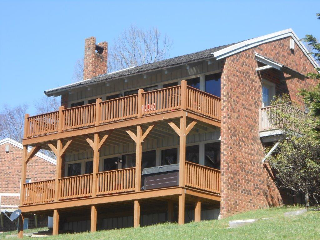 "Just off the Blue Ridge Parkway in the Doe Run community, this upper level ""Piedmont View Chalet"" unit has a lovely Piedmont view.  2 bedrooms, 2 baths, great room with cathedral ceiling.  Lots of recent updates: flooring, enlarged deck, windows.  Fully furnished. HOA fee includes water, sewer, road maintenance.  And now you can enjoy a weekend dinner at the onsite Doe Run Restaurant! Buyer to determine internet availability."