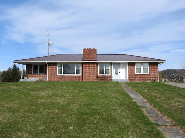 Move in ready! Nice, 3 bedroom, 1 bath, brick home located in the heart of Elk Creek. Surrounded by beautiful mountain views. House sits on nice, level lot, has metal roof and vinyl windows.