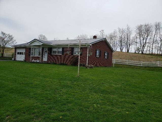 COUNTRY LIVING AT IT'S BEST!  NICE & NEAT 3 BEDROOM 1 BATH BRICK RANCH HOME SITUATED ON 2 ACRES WITH A VIEW! HARDWOOD FLOORING, FULL BASEMENT, ATTATCHED CARPORT AND OUTBUILDING! FENCED LOT FOR YOUR ANIMALS! CLOSE PROXIMITY TO THE JEFFERSON NATIONAL FOREST & STOCKED TROUT STREAMS!