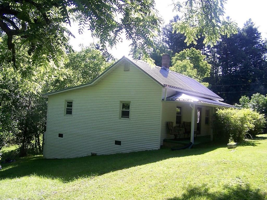 If you are Looking for a Charming Country Cottage, then look no further!  This Adorable 2 Bedroom/1 Ba home is Sitting on just under an Acre in the Elk Creek Community of Grayson County. The Current Owner has added many New Features and Upgrades such as:CounterTops,BackSplash, BeadBoard,Paint,Custom Built Barn-Style Doors,Completely Remodeled Bathroom,3 Stage Water Filtration System for the Drinking Water (2 Stage for the rest), 200 Amp Electric Service (Box and Tower),Kitchen Stove,Pressure Tank in SpringHouse,PVC Plumbing,Dorm Style Washing Machine, and Nice Landscaping. The house has been Plumbed and Wired for a Stackable Washer/Dryer as well.  Roof/Siding/Windows were upgraded @10 Yrs ago. Outside you will find a Covered Front Porch, and a Swing in the Side Yard to sit and Listen to the Relaxing Sounds of the Little Branch Running through the Property, or Perhaps sit by the Fire Pit and Roast some Hot Dogs, or make some S'Mores with the Family. So Many Possibilities!