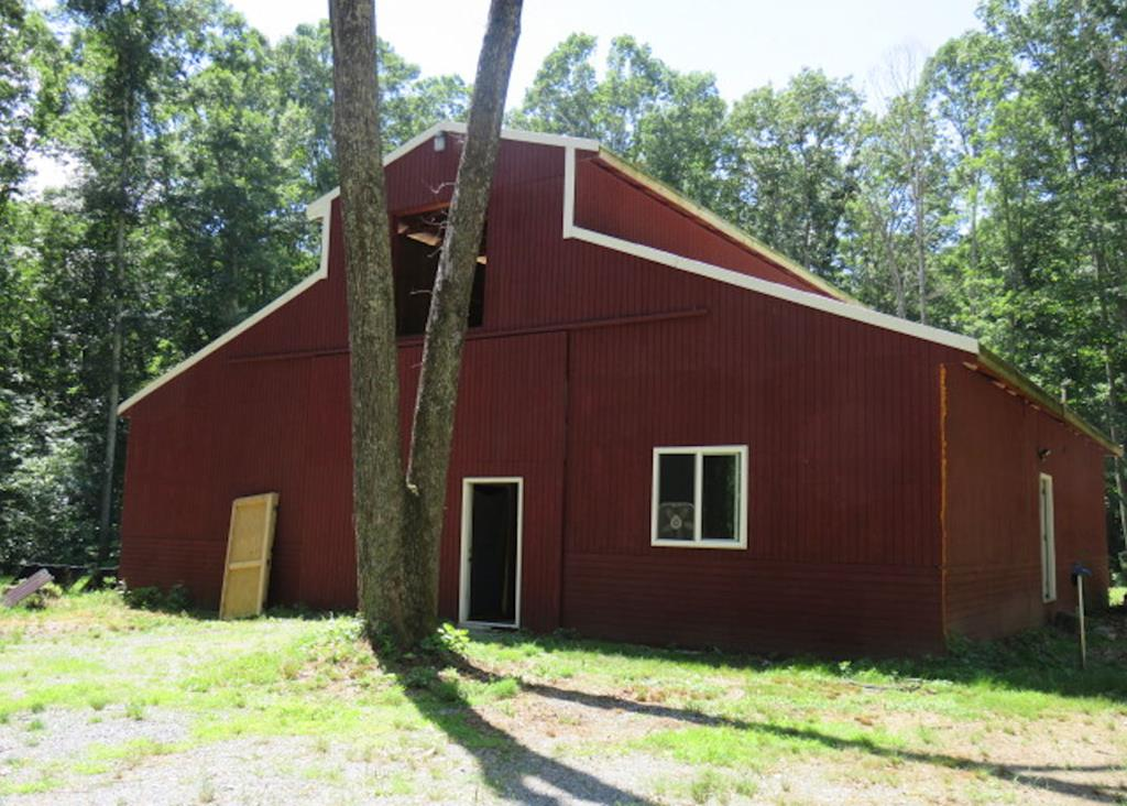 """Unique property! Privacy & seclusion; peaceful & tranquil; across the road from the South Fork of Holston River. Large barn on the property; main level is 48x48 loft is 16x48. The main level has been used for living space consisting of a kitchen, living area, framed in 2 bedrooms & bath. Current owner planned to live in barn while building on the property. The electricity is solar - battery powered & generator. Septic tank & well are already in place. The woodstove, clawfoot tub, kitchen sink, washer, dryer, stove & refrigerator & propane tanks will not convey with the sale.  Enjoy nature & wildlife from your own private retreat.  Sold """"As Is""""."""