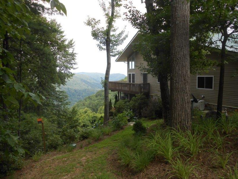 At the end of a cul-de-sac in peaceful Elkhorn Acres, just off the Blue Ridge Parkway, you will find this lovely home with a truly amazing view.  At approximately 2500 square feet, it is suitable for either full time use or weekend/vacation use.  3 bedrooms, 2 baths.  Other included lots are 4011-2-19, 4011-2-20, 4011-2-21, 4011-2-22, 4011-2-23. Acreage of the 7 lots is estimated. Internet availability to be determined by buyer. HOA fee covers road maintenance. Parcels 4011-2-56 (17.22 acres) and 4011-2-58 (17.25 acres) are also available for sale. Whole house generator.