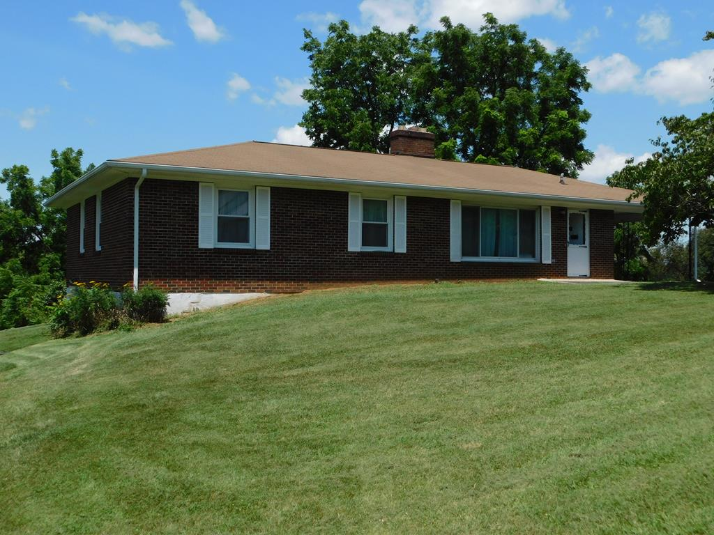 WELL BUILT BRICK RANCH WITH BASEMENT IN NEED OF A  LITTLE LOVE! THIS HOME SITS ON A LARGE LOT AND OFFERS SOME MOUNTAIN VIEWS. IT FEATURES A NICE KITCHEN WITH BREAKFAST AREA, LARGE LIVING ROOM WITH HARDWOOD FLOORS. THE MASTER BEDROOM HAS AN AREA RUG BUT THERE ARE HARDWOOD FLOORS UNDERNEATH, LARGE CLOSET AND HALF BATH. THE TWO ADDITIONAL BEDROOMS ALSO WITH HARDWOOD FLOORS. THERE'S A NICE SIZE MUDROOM/LAUNDRY ROOM COMBINATION. THERE ARE NEWER WINDOWS, HEAT PUMP (SERVICED YEARLY), ATTACHED CARPORT AND A GARAGE IN BASEMENT AREA. NEW SEWER LINES REPLACED IN 2018.