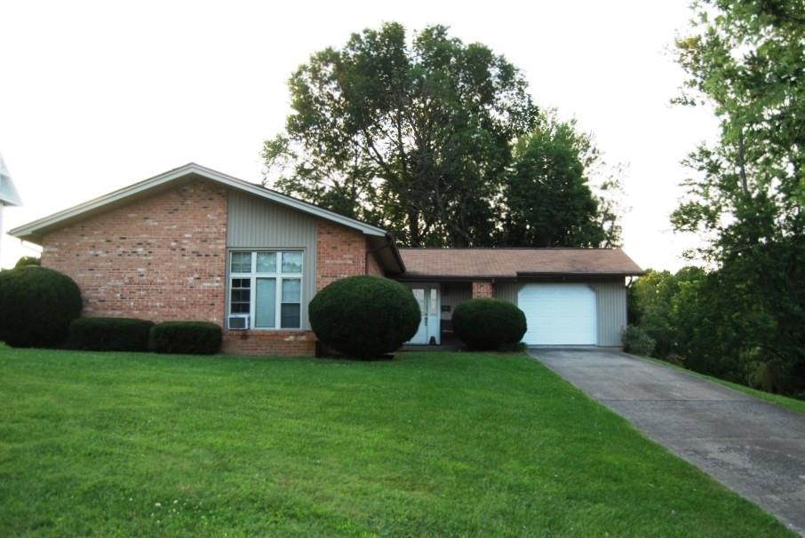 Precious memories begin here in this 3 bedroom, 2 full bath, well built brick home. This home offers single level living, hardwood floors, newer appliances that include dishwasher and microwave.The large family room with a beautiful brick fireplace will be the center of entertaining inside and out opening onto the deck to expand leisure activities to the outdoors. The unfinished basement can be completed to add finished living space if needed or provide ample storage for all your belongings.  Enjoy relaxing surroundings with the large windows all across the back side of the home offering lots of natural light.  Take in the views of the beautiful mature trees as well as the rolling Jackberry Historical Spring located in the back yard. The original spring house is still in place. Listen to the sound of the lovely waterfall as you unwind on the spacious deck. The stone steps,green foliage and shade trees add a private park like atmosphere to this beautiful setting.