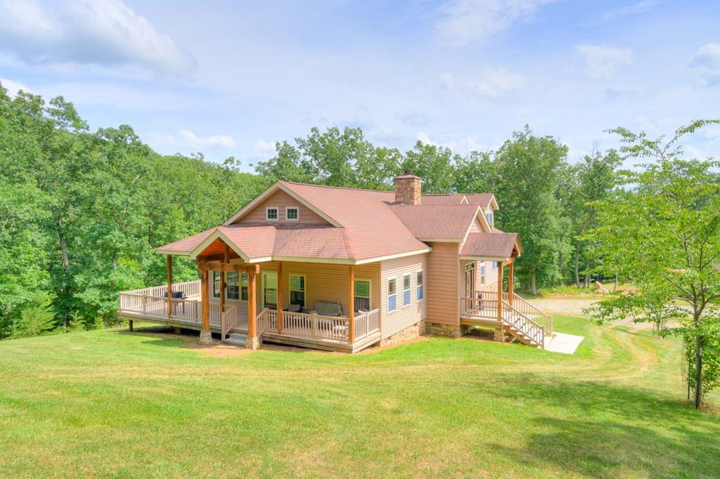 With almost 600 acres, this custom built 3BR, 3.5BA home is located in a very private setting with a pond, cleared yard and beautiful barn, stick-built with Hardy plank, with a massive amount of storage space. Enjoy the open floor plan of this Lodge inspired home, adorned with a stone, wood burning fireplace, huge vaulted ceilings and marble hearth w/ all the bedrooms on the main level. You will enjoy the luxurious tiled shower in the master bath. The space upstairs is perfect for entertaining including a game room and a gorgeous room perfect for playing cards, a sun room or perfect space of an office with outside access to the deck below. There is abundant wildlife and fishing that is perfect for the outdoor enthusiast! Many trails throughout the property with food plots set up for deer and turkey management! Must see!