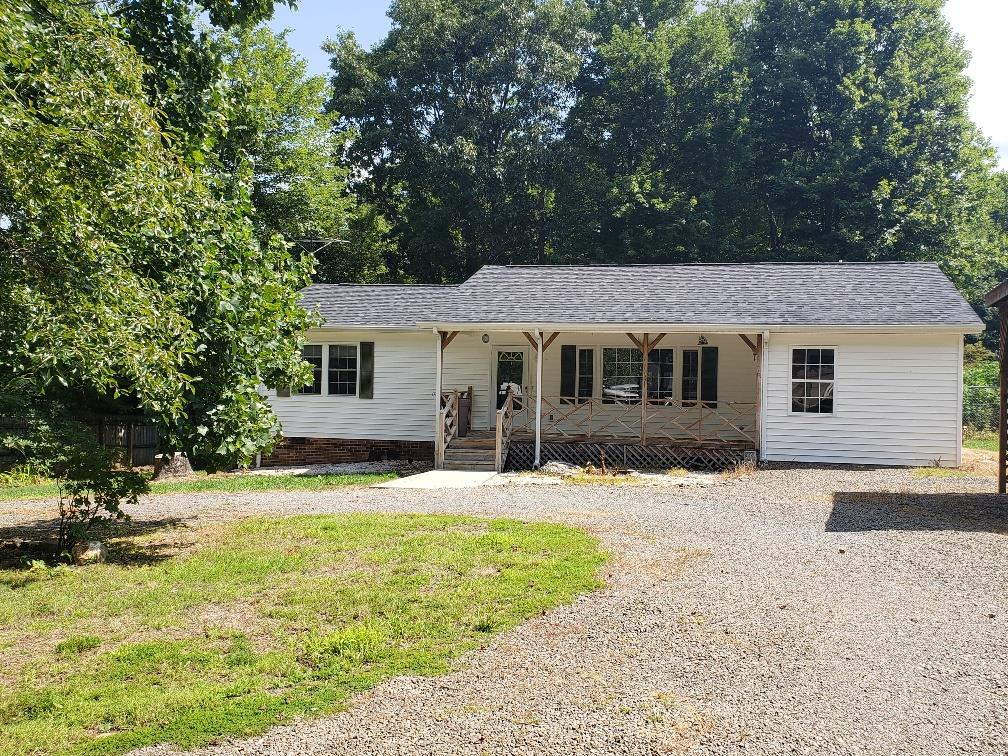Very nice 3 bedroom 2.5 bath home situated on a level lot in Grayson County! Vinyl sided with new roof installed in 2019, heat pump, covered front porch and covered deck, outbuilding, detached carport and more. Includes a bonus room with a kitchenette.