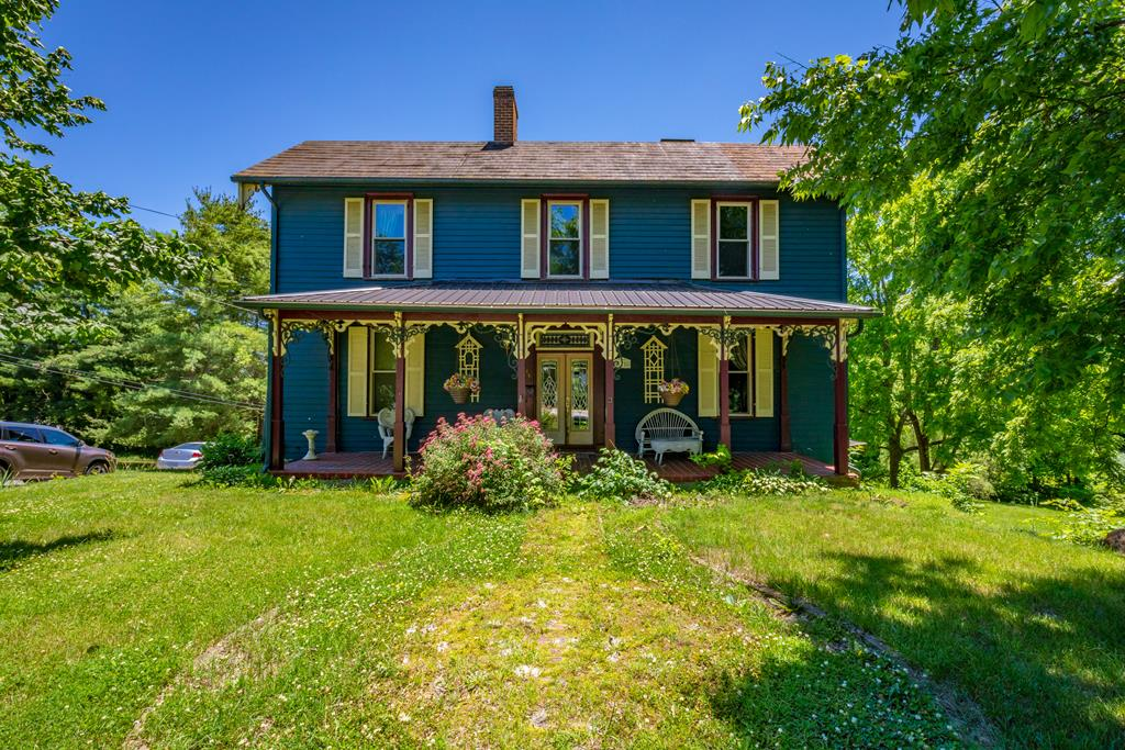 Take an exhilarating walk in history through this historic home built in the late 1800's and featured in Wytheville's Historic walking tour with over 4599 sq ft, 3 levels (2 at ground level on adjoining streets).  Adorable curb appeal with Gingerbread trim.  5 bedrooms, huge walk in closet, 3 large bathrooms with antique claw tub and jet tub, various living & family rooms, large kitchen, 34' front porch, tilt-out windows, 3 heat pumps and newer metal porch roof. Built by the Rich Brothers. Beautiful hardwood floors, open kitchen, most bedrooms are 16 x 16 with fireplaces that are no longer used.  Two of the bathrooms are the size of living rooms. Laundry room off of the kitchen.  Living/Family rooms on 2 levels.  Home is perfect for a large family or a couple that wants plenty of space.  Would also make a wonderful bed & breakfast. Addt'l lot with creek is available. Home needs some painting, some outside wood replaced & other repairs and being sold as is and priced accordingly.