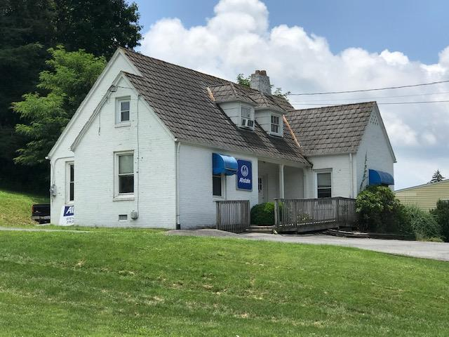 Excellent opportunity to purchase a great income producing property on Main Street. This could be the perfect place for your business OR may be packaged with adjoining vacant lot for additional possibilities. (see agent for details).