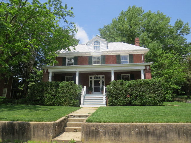 Open the door to this 1906 Federal Style Home with Doric columns. Home has been loved by its current owner for over 25 years. Enjoy Large Rooms with 10 foot ceilings throughout. Many original features remain including solid oak doors and pocket doors, 6 oak fireplaces with various colors of hand laid tile-delft blue, shades of green and yellow and one with varying shades of red. Four of the fireplaces have been converted to gas. Beautiful Palladian window on the west side of the home sits over a seat for reading. Butlers pantry, original floors, wainscoting, claw foot tub are part of her charm.  Wide staircase in the entry as well as a staircase that leads back to the kitchen.Modern features include: White Wood-Mode Cabinetry in the kitchen with glass fronts, new appliances and counter tops.